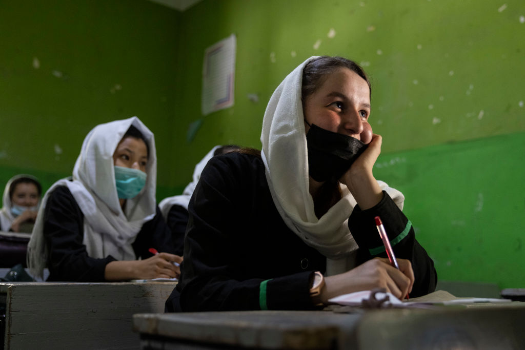 KABUL, AFG- JULY 25: Zinat Karimi, 17, listens during 10th-grade class at the Zarghoona high school on July 25 2021 in Kabul, Afghanistan. The Zarghoona girls high school is the largest in Kabul with 8,500 female students attending classes. The school opened after almost a two months break due to the coronavirus (COVID-19) pandemic. Currently, there is widespread fear that the Taliban who already control around half the country will reintroduce its notorious system barring girls and women from almost all work, and access to education. The Ministry of Education has announced the opening of schools, but there are mixed reports in many areas where the Taliban have taken control or where fighting is ongoing. (Photo by Paula Bronstein /Getty Images)